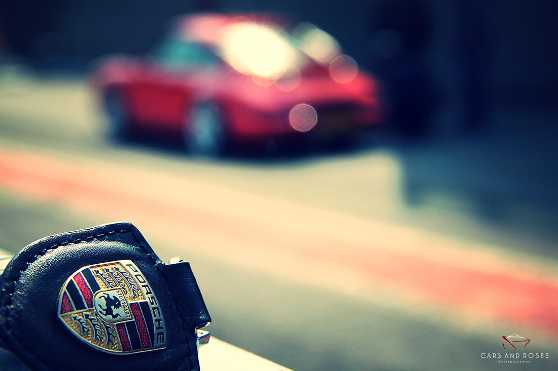 Porsche Key and 911 Carrera in Background